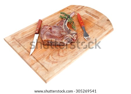 meat food : grilled beef spare rib on wooden plate with thyme isolated over white background - stock photo