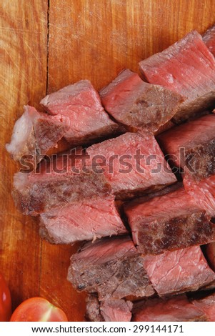 meat food : roast beef steak on wood plate isolate on white background - stock photo