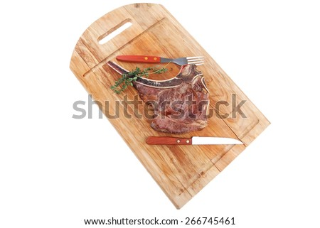 meat food : roast rib on wooden plate with thyme isolated over white background - stock photo