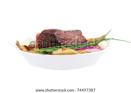 meat food : roasted fillet mignon on bread in white bowl garnished with tomatoes salad isolated over white background - stock photo