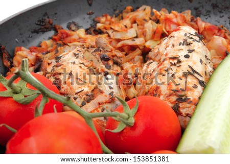 meat grilled chicken fillet cooked with vegetables on ceramic pan isolated over white background - stock photo