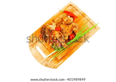 meat : grilled quarter chicken garnished with green sprouts and red peppers on wooden plate isolated over white background - stock photo