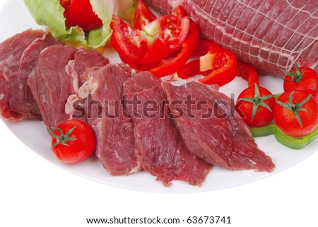 meat in grid with tomatoes on white - stock photo