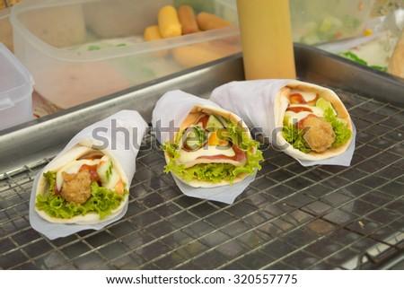 Meat Kebab in a bun at thai market - stock photo