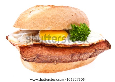 Meat loaf on a roll with fried egg isolated on white background