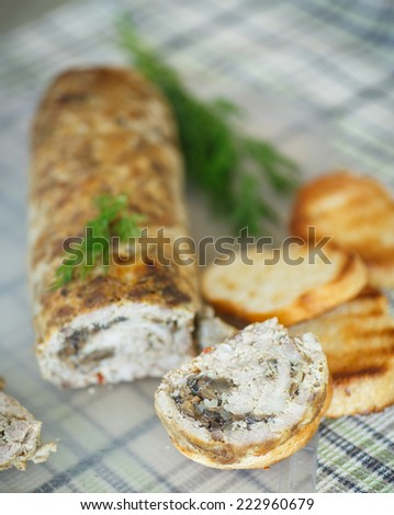 meat loaf swirled with mushrooms on the table - stock photo