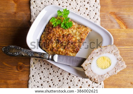 Meat Loaf with boiled egg on a wooden background. Selective focus. - stock photo