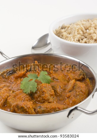 Meat Madras served with pilau rice - stock photo