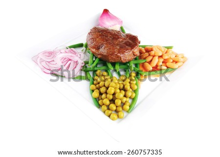meat medalion on green beans with vegetables - stock photo
