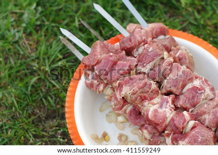 Meat of a shish kebab on a skewer. Preparation of a shish kebab - stock photo