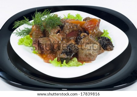 Meat of the rabbit on a black and white plates isolated - stock photo