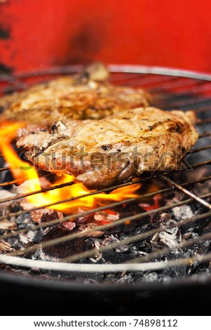 Meat on a grill (shallow dof) - stock photo