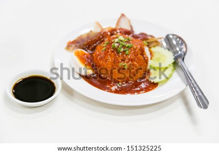 Meat on and rice and red stock sauce on rice - stock photo