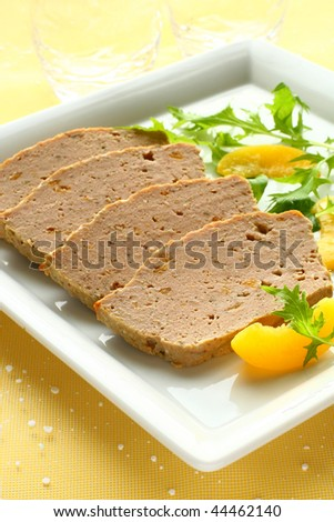 meat pate with peach and salad garnish