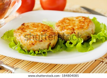 Meat patties on a white plate. Served with fresh vegetables. - stock photo