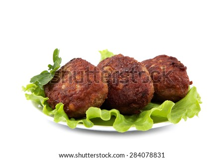Meat patties with fresh lettuce isolated on a white background. - stock photo