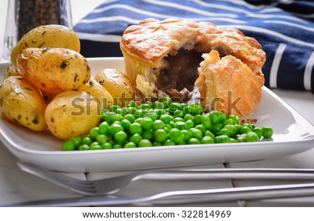 Meat pie with new potatoes and peas.