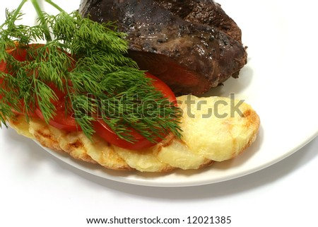meat piece and vegetables