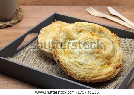 """Meat pies filled with veal meat, ham, chorizo sausage, bacon, tomatoes, green peppers and boiled eggs. Traditional Murcian meat pie named """"pastel murciano"""" - stock photo"""