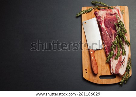 Meat pork fresh. Raw meat on cutting board. Rosemary spice and meat. Axe and meat pig. Fat piece - stock photo