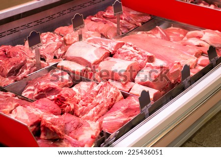 meat products in in small butcher shop - stock photo
