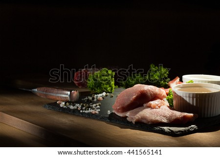 meat products on a dark background - stock photo