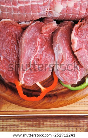 meat ready to cooking over wooden table