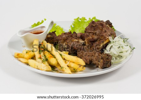 Meat roasted prime rib, fresh cucumbers, tomato on a plate - stock photo