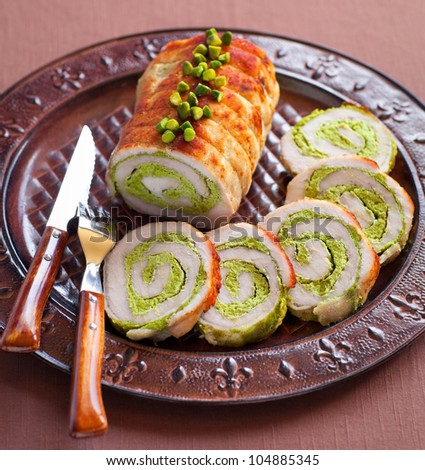Meat roll stuffed with pistachio, selective focus - stock photo