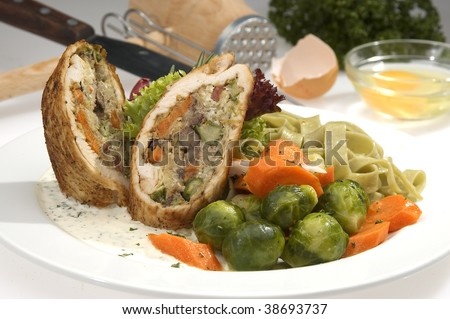 Meat roulade filed w vegetable and mushrooms - stock photo