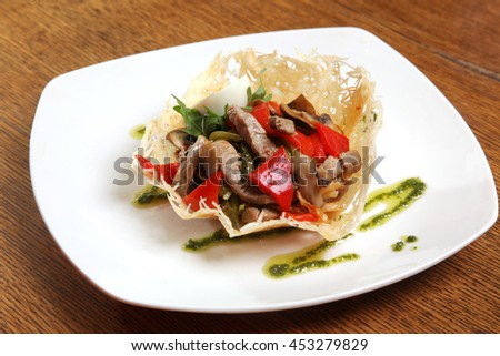 meat salad in cheese crust on plate