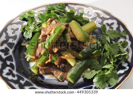 meat salad with cucumber on asian plate