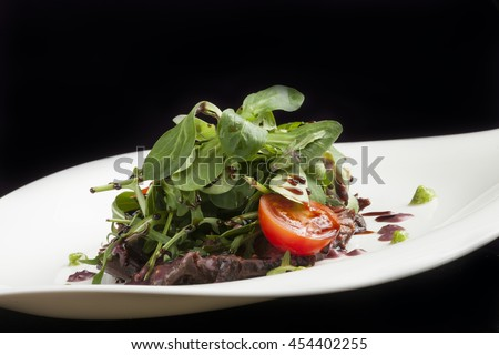 Meat salad with spinach and vegetables, selective focus - stock photo