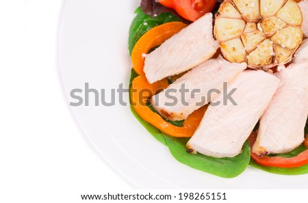 Meat salad with vegetables. On a white background.