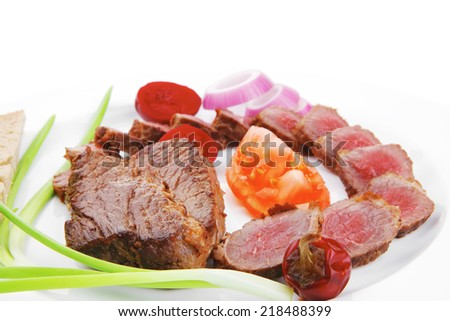 meat savory : roasted bbq meat served on white plate with tomatoes , sprouts and bread isolated on white background