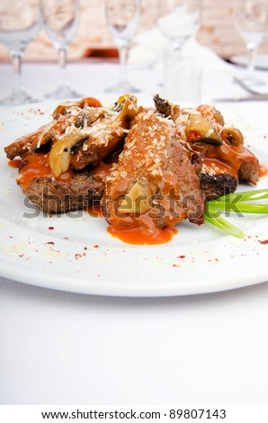 Meat served with sauce in the plate - stock photo