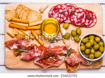 Meat set for a quick snack on a cutting board - stock photo