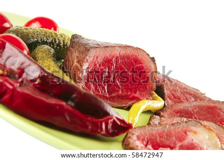 meat slices and chunk with vegetables and peppers - stock photo
