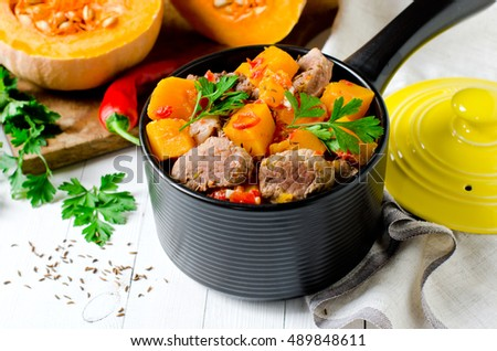 Meat stew with pumpkin, peppers and carrots