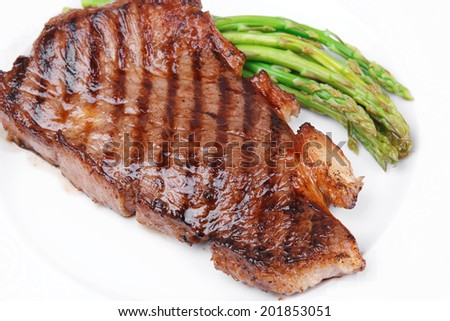 meat table : rare medium roast beef fillet with asparagus served on white dish