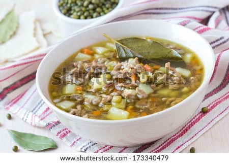 Meat winter soup with beef, mung green beans, legumes, potatoes, hot Indian oriental dish - stock photo