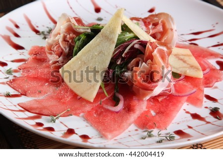 meat with cheese and watermelon on plate - stock photo