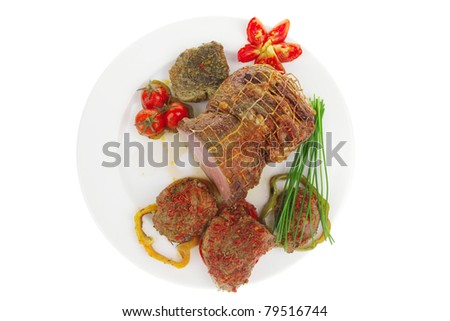 meat with chives and tomatoes over white plate - stock photo