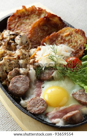 meat with egg and slap jacks in pan - stock photo