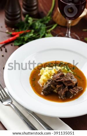 Meat with mashed potatoe - stock photo