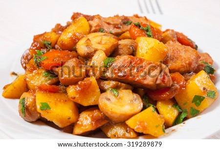 meat with mushrooms and vegetables - stock photo