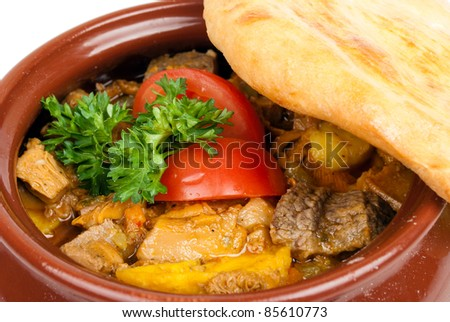 Meat with mushrooms baked in a pot