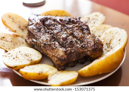Meat with potato lunch served in a white plate