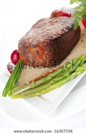 meat with spices and eggplant on white plate