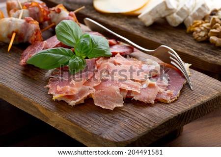 meat wooden platter - stock photo